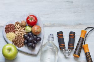 Healthy lifestyle concept with diet and fitness on blue boards